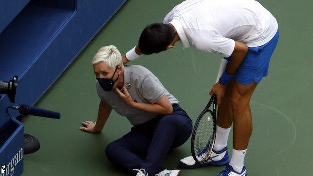 Novak Djokovic checks on the line judge after hitting her with a ball