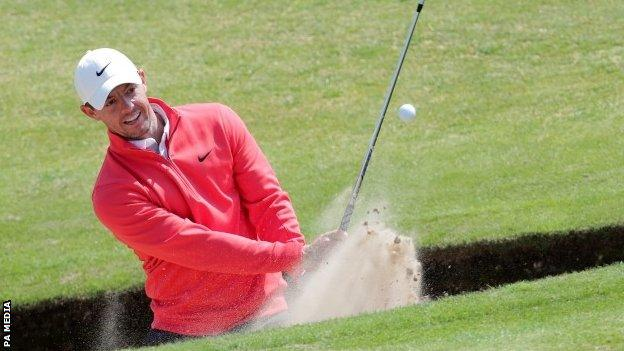 Rory McIlroy playing out of a bunker at Royal St George's