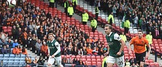 Jason Cummings watches his penalty sail over the bar