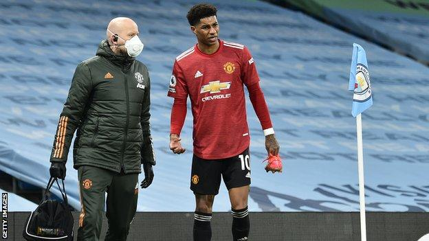 Marcus Rashford walks off the pitch as he is substituted after receiving an ankle injury.