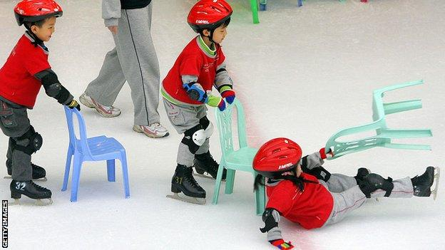 Children struggle to get to grips with ice skating