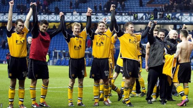 The Annan Athletic players celebrate a famous victory at Ibrox as they beat Rangers 2-1 in the Third Division