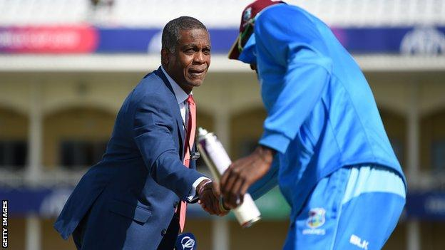 Michael Holding shakes hands with Jason Holder