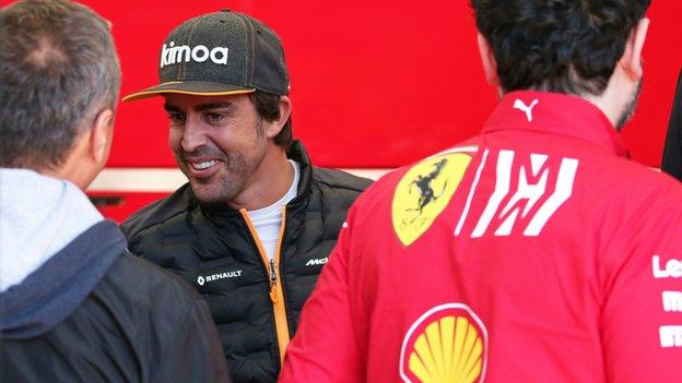 Fernando Alonso with members of the Ferrari team at Barcelona for testing in February