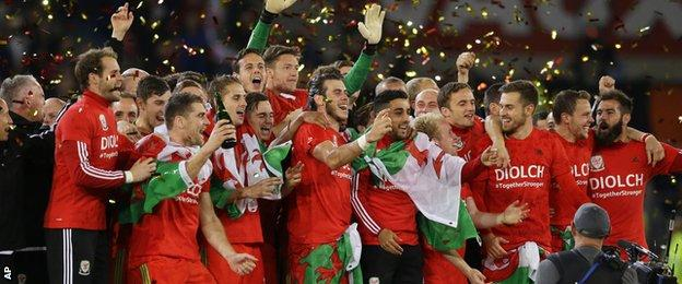 Wales players celebrate after defeating Andorra