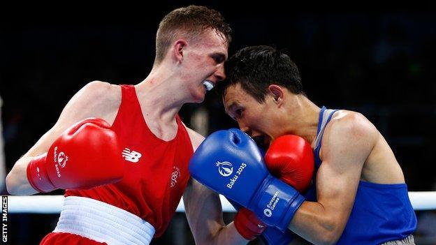 Brendan Irvine in action against Bator Sagaluev in the light-flyweight final