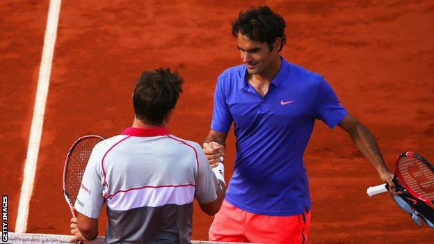Roger Federer shakes hands with Stan Wawrinka after being beaten in the last eight in 2015