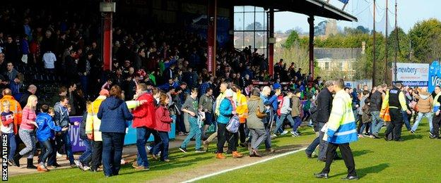 Fans are evacuated from a stand at Exeter's St James Park