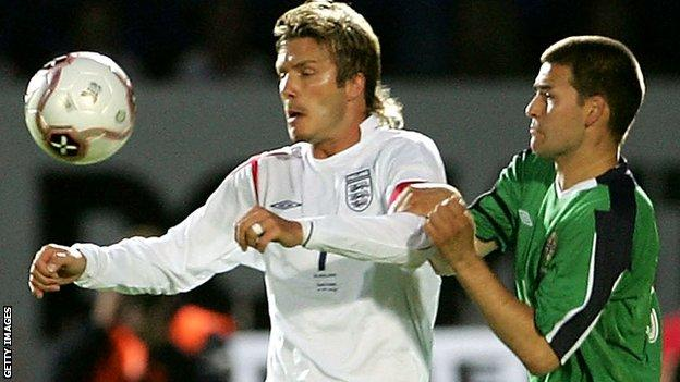 England's David Beckham in action against David Healy of Northern Ireland
