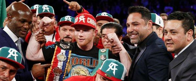 Canelo (red cap) now has 47 wins with 33 knockouts in his career