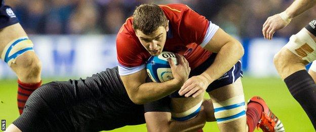 Scotland's Adam Ashe takes on the New Zealand defence