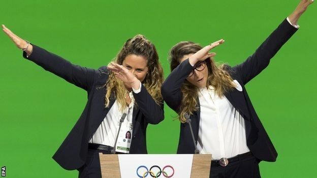 Italian snowboarder Michela Moioli and skier Sofia Goggia dab after giving a presentation to the IOC