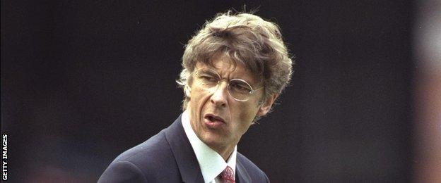 Arsene Wenger on the touchline as Arsenal manager in 1996