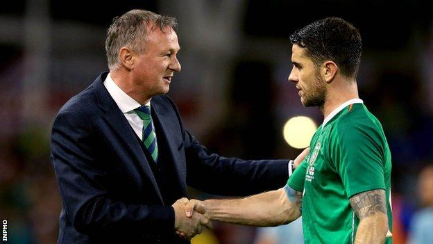 NI manager Michael O'Neill and Robbie Brady