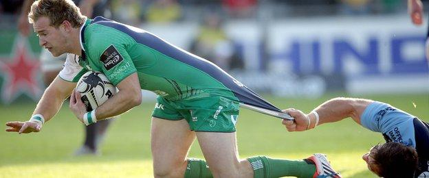 Kieran Marmion breaks away to score Connacht's opening try despite a tug from Josh Turnbull