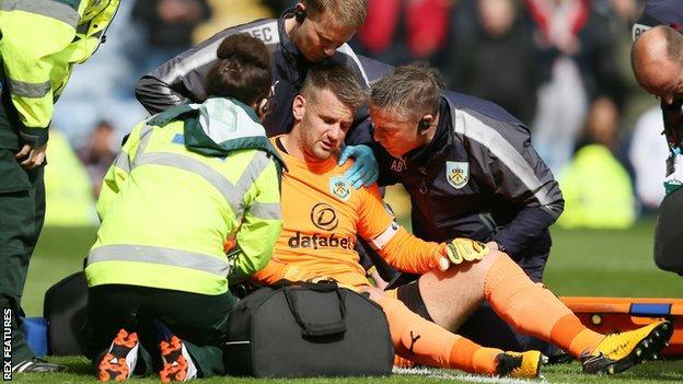 Tom Heaton receives treatment