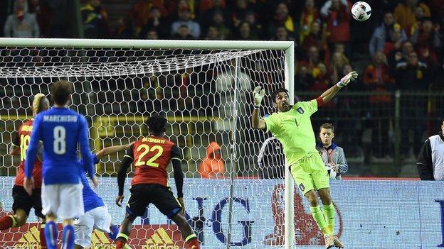 Gianluigi Buffon is beaten by a lob from Belgium's Kevin de Bruyne