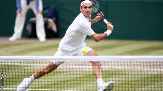 Roger Federer plays at Wimbledon