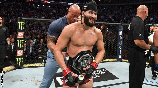 Masvidal is presented with his 'BMF' title after victory over Nate Diaz in November