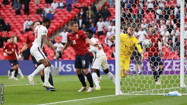 Raheem Sterling scores the opener for England