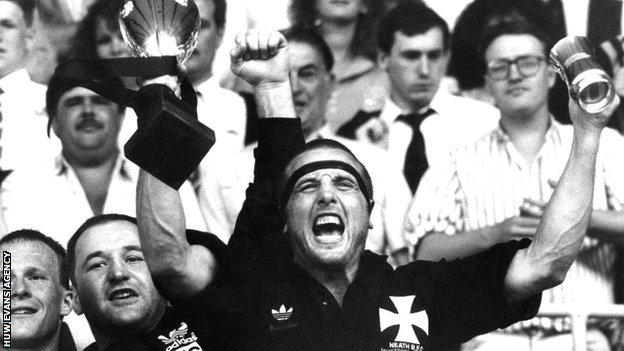 Neath captain Kevin Phillips lifts the Schweppes Cup in 1990