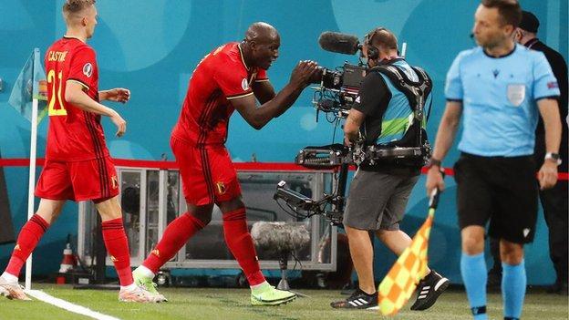 "Belgium's Romelu Lukaku shouts in front of a TV camera ""Chris, Chris, I love you"" in tribute to Christian Eriksen after scoring against Russia"