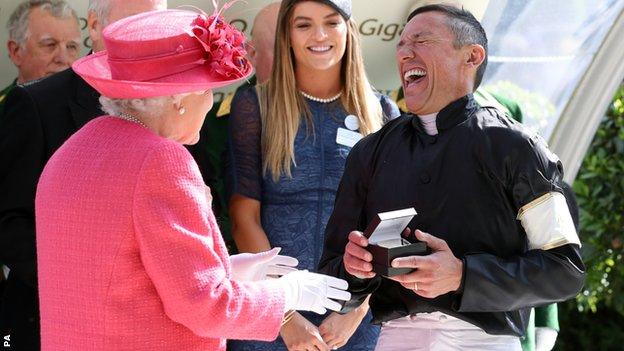 The Queen shares a joke with Frankie Dettori during the presentation of his winner's medal