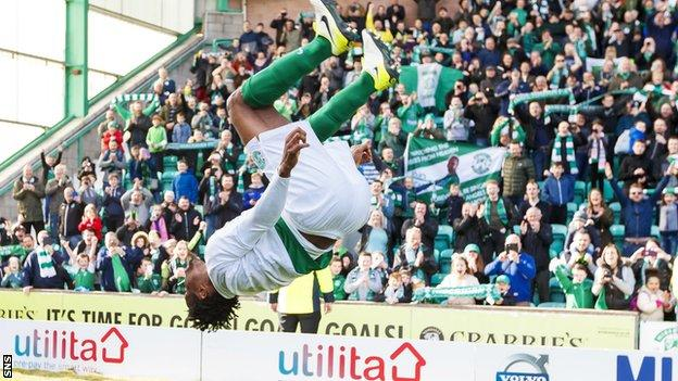 Hibs defender Efe Ambrose does a somersault to celebrate their promotion