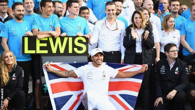 British driver Lewis Hamilton celebrates a fifth world title