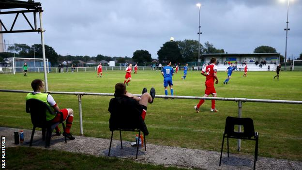 Substitutes social distance during the first half of the pre-season friendly match between Fawley AFC and Stockbridge