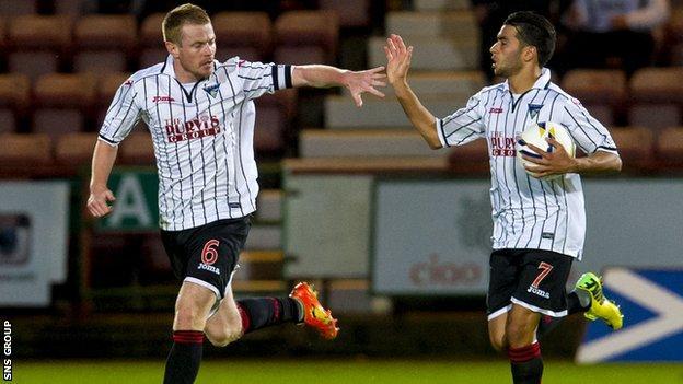 Dunfermline captain Andy Geegan (left) celebrates with team-mate Faissal El Bakhtaoui.