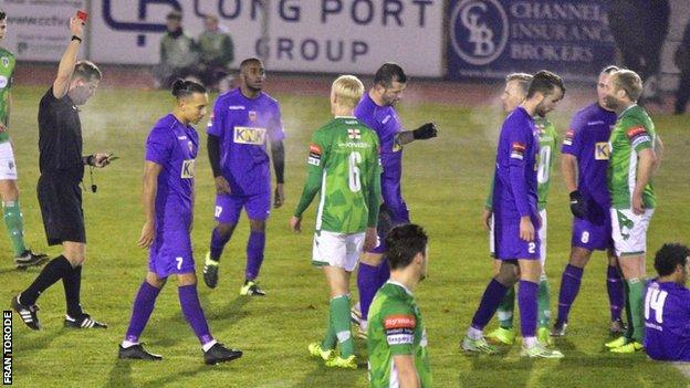 Marc McGrath (second Guernsey player from right) is sent off late-on for Guernsey FC