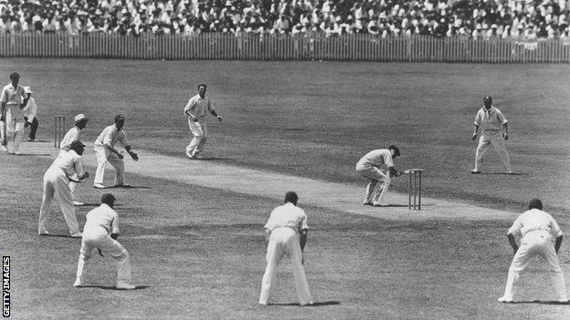 England's Harold Larwood bowls during the 1932-33 Ashes