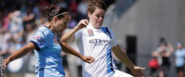 Jennifer Beattie (right) challenges Sydney's Kyah Simon as Melbourne City win the W-League final