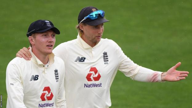 England's Dom Bess and Joe Root