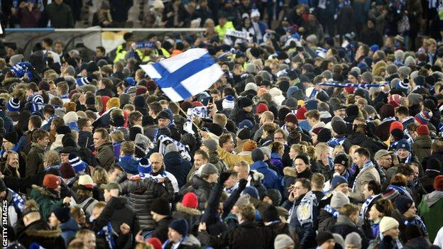Finland fans invade the pitch