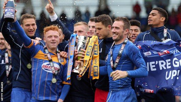 The 2014-15 League Two runners-up Shrewsbury Town celebrate promotion