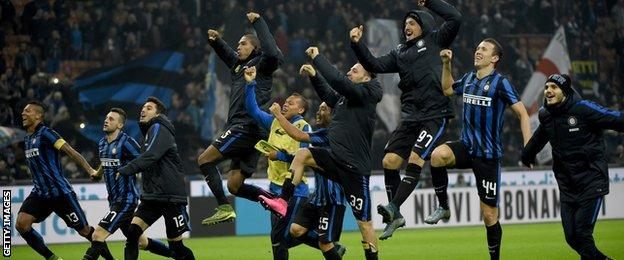 Inter Milan's players celebrate going top of the table