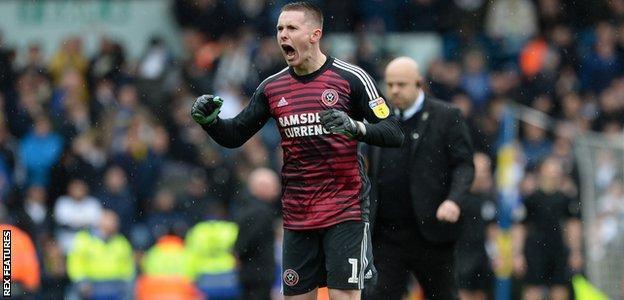 Sheffield United goalkeeper Dean Henderson celebrates their victory at Leeds