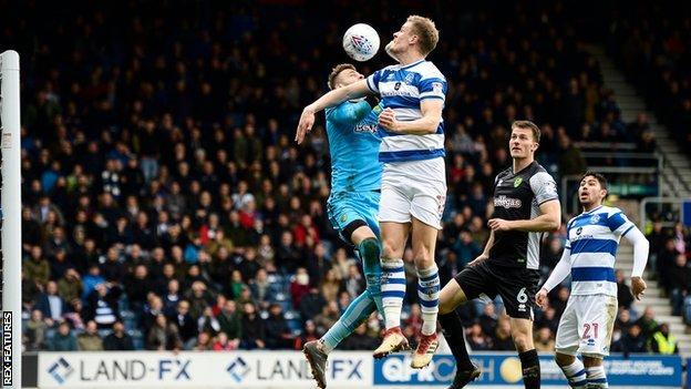 Matt Smith of QPR scores with a header 2-1