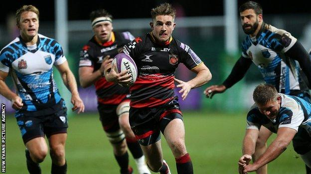 Arwel Robson bursts through the Enisei defence to set up Dragons' first try
