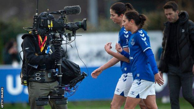 Camera following Everton players during a WSL game