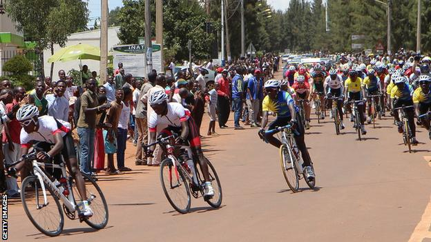 Cyclist ride through Kigali during the Tour of Rwanda
