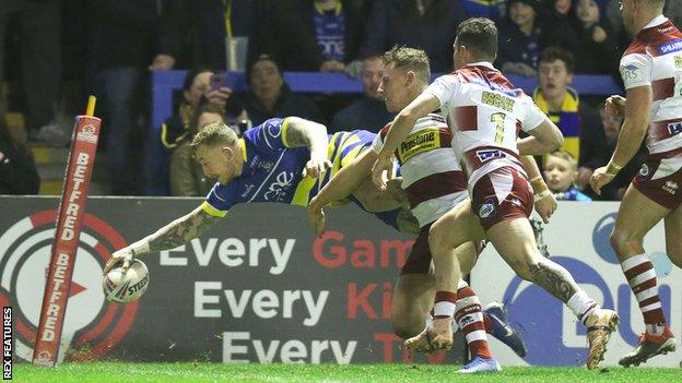 Josh Charnley scores a try for Warrington against Wigan