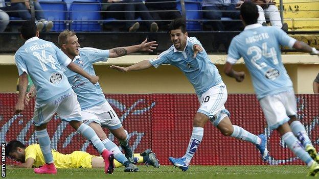 Celta Vigo players celebrate the winning goal