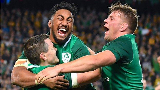 Ireland's Johnny Sexton, Bundee Aki and Jordi Murphy celebrate victory