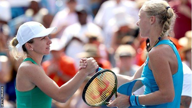 Simona Halep and Kiki Bertens shake hands at the net