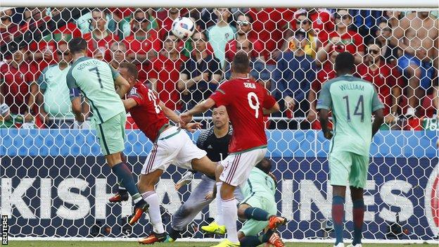 Portugal forward Cristiano Ronaldo scores a header for his country against Hungary