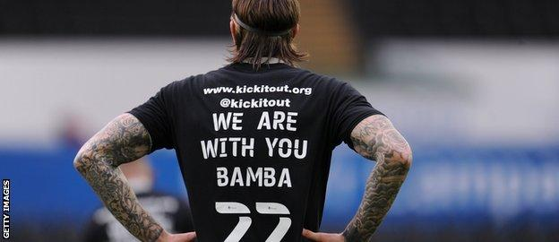 Aden Flint wears a shirt with 'We are with you Bamba 22' on it