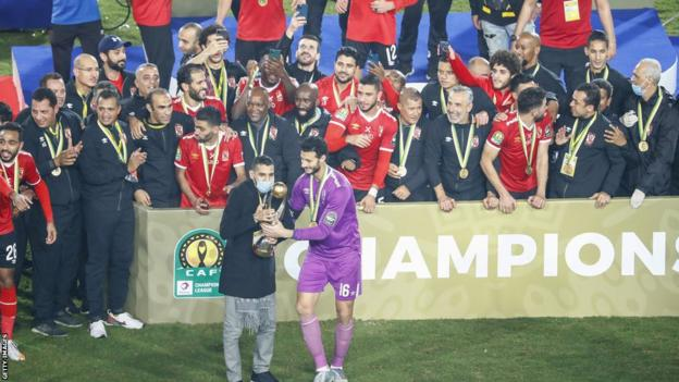 Al Ahly lifting the 2020 African Champions League trophy